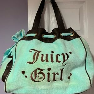preowned juicy handbag  few stains no wrip or tear